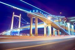 Light trails on the modern bridge Stock Photography