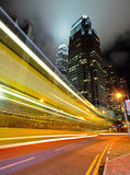 Light trails with modern building Stock Images