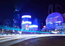 Light  trails on the modern building background. Night light  trails on the modern building background in shanghai china Stock Images