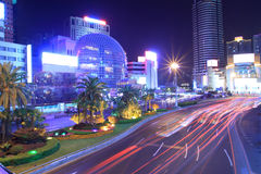 Light  trails on the modern building background. Night light  trails on the modern building background in shanghai china Stock Photo