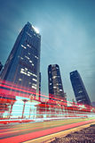 The light trails on the modern building background Royalty Free Stock Photo