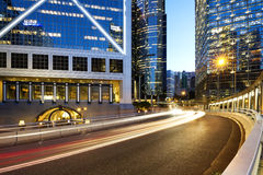 light trails on the modern building background Stock Photos