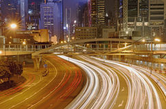 Light trails on the modern building background. In Hong Kong, China Royalty Free Stock Photos