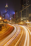Light trails on the modern building background. In Hong Kong, China Royalty Free Stock Images