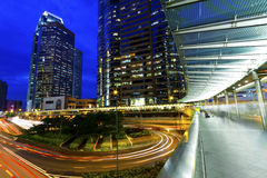The light trails on the modern building background in Hong Kong stock photo