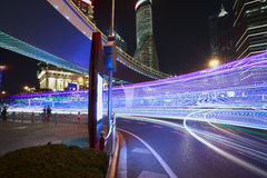 The light trails on the modern building background in shanghai c Stock Photos
