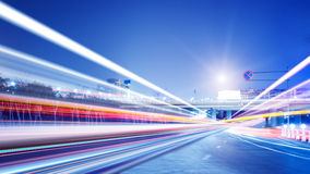 The light trails. On the modern building background in shanghai china royalty free stock image