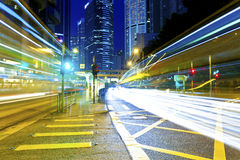 The light trails on the modern building backgrounds in Hong Kong stock photos