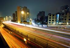 Light trails on modern city Stock Photo
