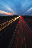 Light trails on the motorway. Night scene of a motorway with light trails of the driving vehicles stock photos