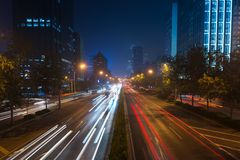 Light trails on motorway highway at night stock images