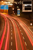 Blurred lights of a motorway at night. High angle view of red blurred traffic lights on a curving motorway or highway at night Royalty Free Stock Photography