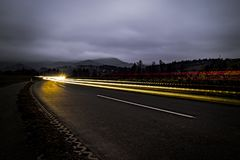Light trails on mountain road.  Stock Photo