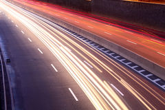 Light trails of moving cars Stock Photo