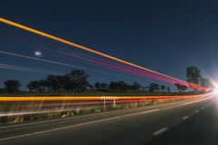Light trails at night with flare Royalty Free Stock Images