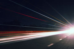 Light trails at night with flare Stock Photos