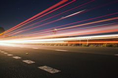 Light trails at night with flare Stock Photo