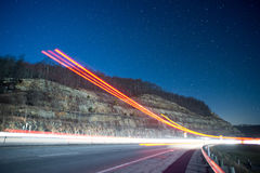 Light trails at night in the mountains from outgoing traffic Stock Photo
