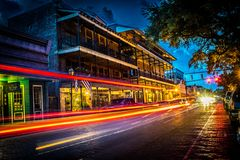 Light trails from night time shot of the shops and restaurants on Front Street in Natchitoches. Night time shot of the shops and restaurants on Front Street in Royalty Free Stock Photography
