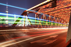Light trails on the old bridge in shanghai Stock Photo