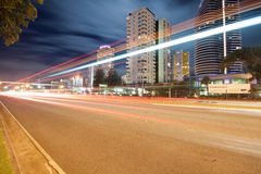 Light trails over modern city at night Royalty Free Stock Photography