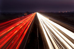Light trails over a motorway. Light trails from traffic taken overlooking a motorway at around dusk Stock Image
