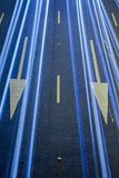 Light trails over traffic signs at night Stock Photo