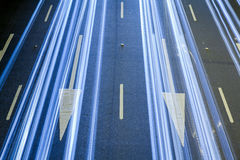 Light trails over traffic signs at night Stock Image