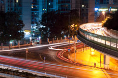 Light trails on the overpasses at night Stock Images