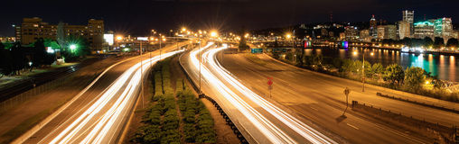 Light Trails and Portland City Skyline at Night Royalty Free Stock Photography