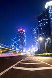 Light trails on the ramp with building background Royalty Free Stock Photography