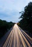 Light Trails on the Road. Car's Speedy Light Trails on the Road at Twilight Time Royalty Free Stock Photo