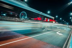 Light trails on road in night city royalty free stock images