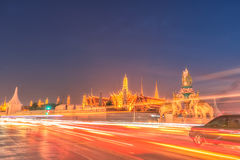 Light trails on the road and Wat phra keaw, Bangkok Thailand Stock Photos