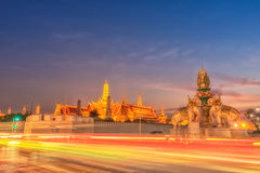 Light trails on the road and Wat phra keaw, Bangkok Thailand Stock Photo