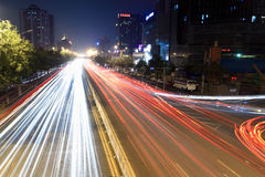 Light trails on rush hour traffic at night. In beijing,China Royalty Free Stock Images