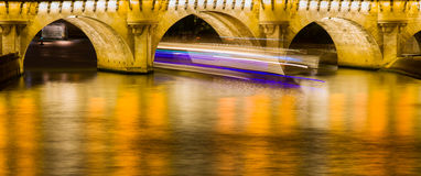 Light trails in Seine Stock Photography