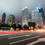 Light trails on shanghai. The light trails on the modern building background in shanghai china Royalty Free Stock Images
