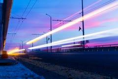 Light trails in Stara Zagora, Bulgaria. Light trails in Stara Zagora, Bulgariq, sunset, bulevard, Bulgarian flag, driving car, pink clouds, beautiful sky royalty free stock photo
