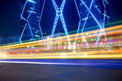 Light trails on the street. Light trails on the modern building background Stock Photos