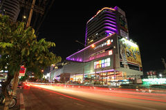 Light trails on street and Central Rama 9 shopping mall Royalty Free Stock Photography
