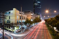 Light trails on street in the city at night Stock Photo