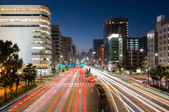 Light trails on the street at dusk in sakae,nagoya city. Royalty Free Stock Photography