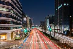 Light trails on the street at dusk in sakae,nagoya city. Royalty Free Stock Photo