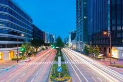 Light trails on the street at dusk in sakae,nagoya  japan. Stock Photos
