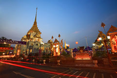 Light trails on street near Traimit temple at dusk Royalty Free Stock Photography