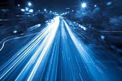 Light trails on street at night Stock Photo