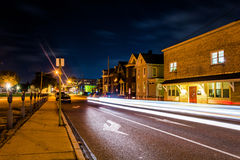 Light trails on a street at night in Hanover, Pennsylvania. Stock Photos