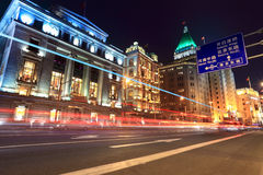 Light trails on the street in shanghai bund. Light trails on the street with classical buildings at night in shanghai Stock Image