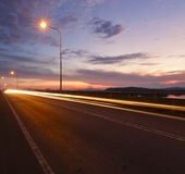Light trails at sunrise in Sabah, East Malaysia Royalty Free Stock Images